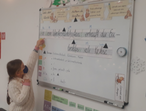 girl at white board